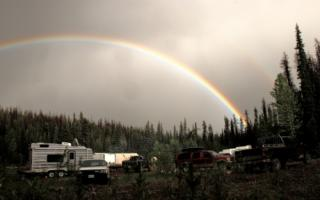 Artisan - rainbow over camp